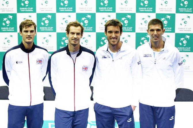 Great Britain's Jamie Murray, Andy Murray, Argentina's Leonardo Mayer and Federico Delbonis pose after the Davis Cup draw in Glasgow, Scotland, on Thursday