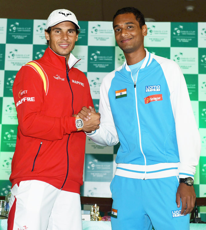 Spanish tennis player Rafael Nadal with India's Ramkumar Ramanathan during the draw ceremony of the World Group Play off tie for the Davis Cup, in New Delhi on Thursday
