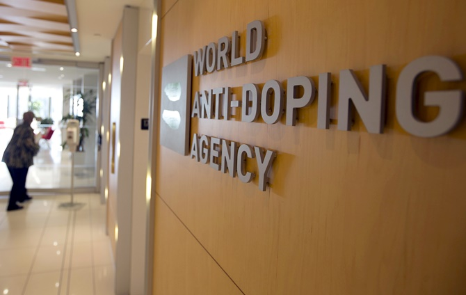 A woman walks into the head office of the World Anti-Doping Agency in Montreal