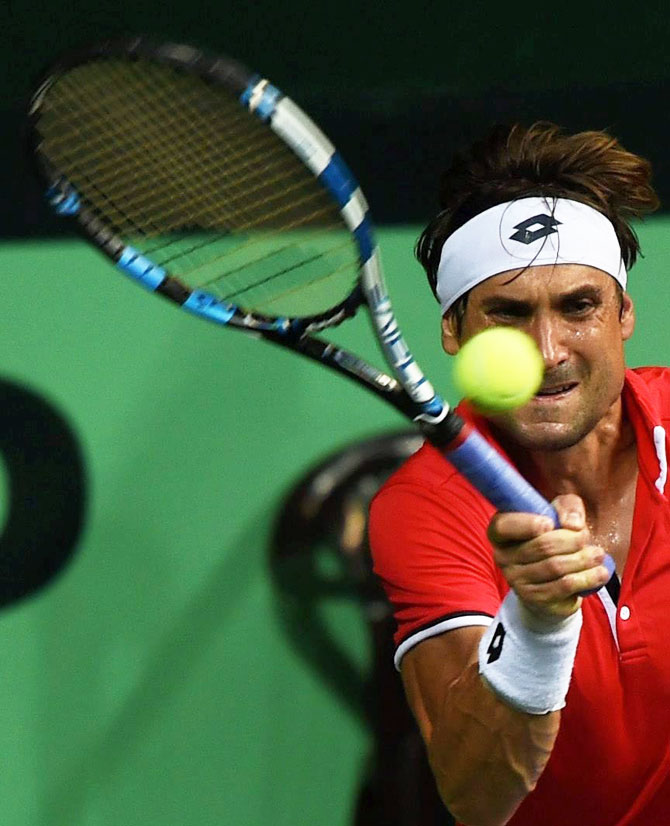 Spain's David Ferrer in action against India's Saketh Myneni during their Davis Cup World Group Play-off tie in New Delhi on Friday