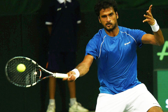 India's Saketh Myneni in action against Spain's David Ferrer