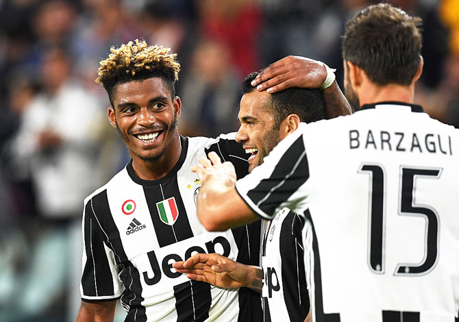 Juventus FC's Mario Lemina (left) of celebrates a goal with teammate Dan Alves during the Serie A match against Cagliari Calcio at Juventus Stadium in Turin on Wednesday