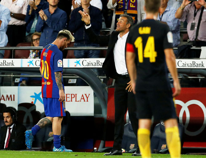 Rediff Sports - Cricket, Indian hockey, Tennis, Football, Chess, Golf - La Liga: Barca held by Atletico after Messi limps off; Real drop points
