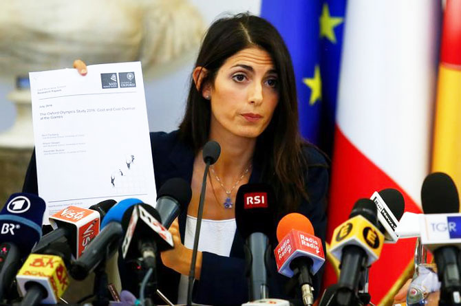 Rome's new mayor Virginia Raggi holds a document during a news conference in Rome on Wednesday
