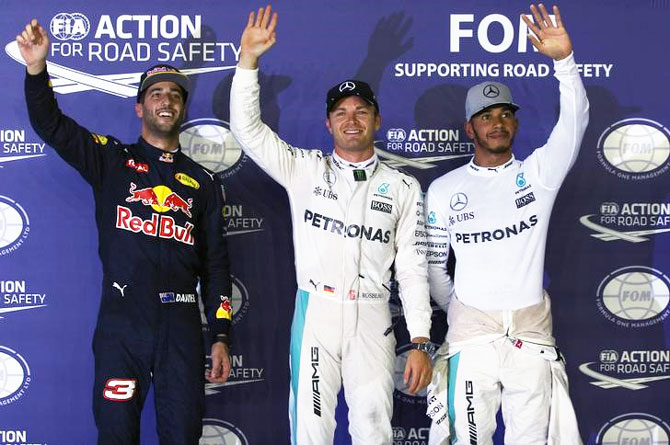 Mercedes' Nico Rosberg and Lewis Hamilton with Red Bull's Daniel Ricciardo