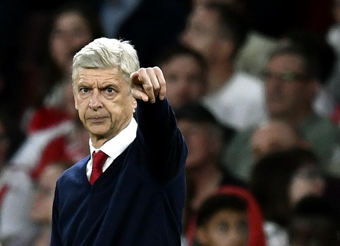 Rediff Sports - Cricket, Indian hockey, Tennis, Football, Chess, Golf - Wenger gives indication on his Arsenal future