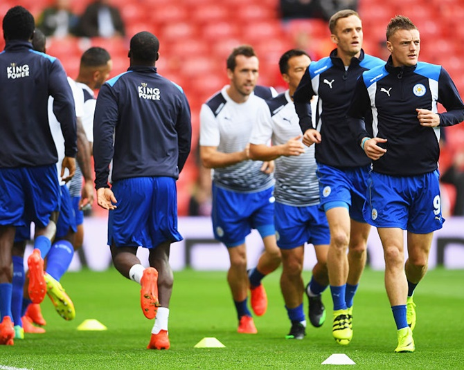 Jamie Vardy of Leicester City, right, warms up with his team mates