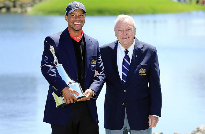 Tiger Woods of the United States with Arnold Palmer at Bay Hill Golf and Country Club on March 25, 2013 in Orlando, Florida