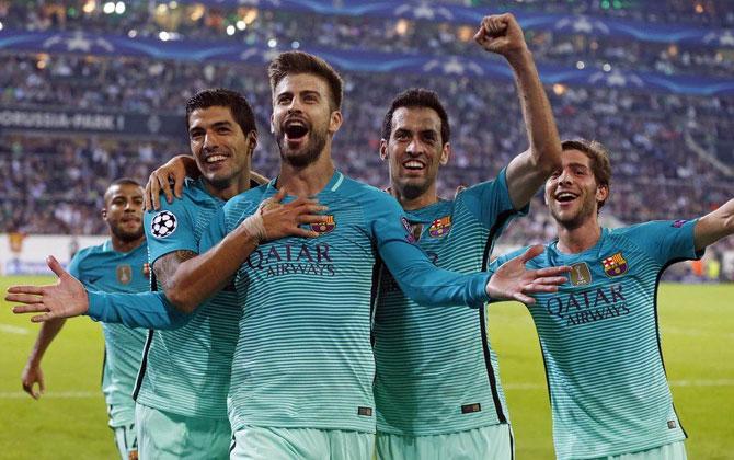 Rediff Sports - Cricket, Indian hockey, Tennis, Football, Chess, Golf - Champions League: Barca rally to down Gladbach; Atletico beat Bayern