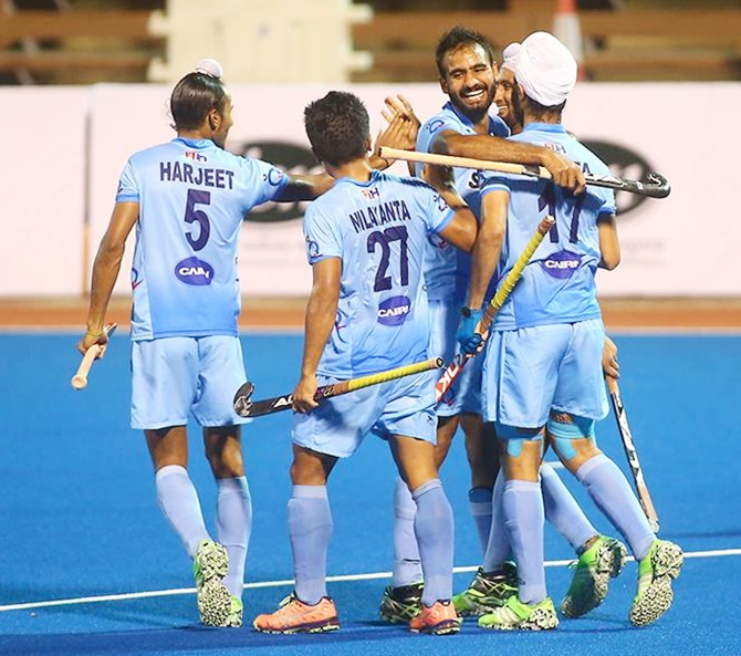 The India U-18 hockey team celebrate a goal