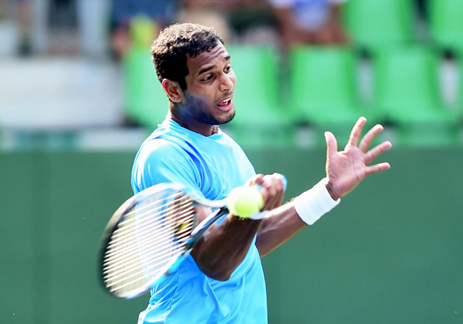 Indian Davis cup player Ramkumar Ramnathan plays a shot during the first singles match of the Asia Oceania Group 1 tie against Temur Ismailov of Uzbekistan at KSLTA, in Bengaluru on Friday