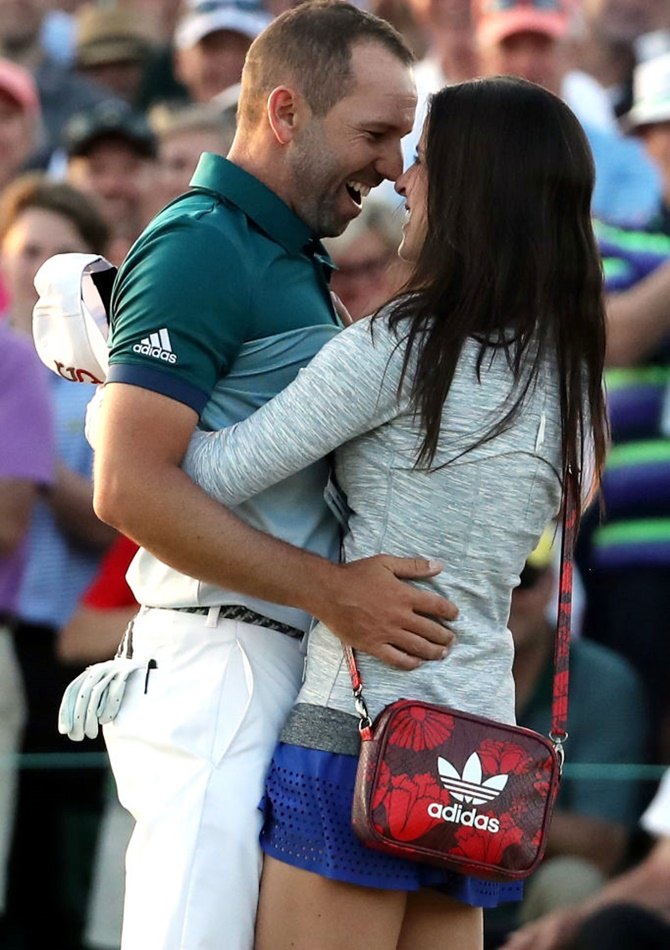 Sergio Garcia of Spain embraces fiancee Angela Akins in celebration after defeating Justin Rose to win the Augusta Masters on Sunday, April 9