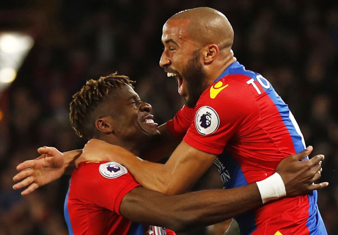 Crystal Palace's Andros Townsend celebrates with Wilfried Zaha after scoring the opening goal against Arsenal during their English Premier League match at Selhurst Park on Monday