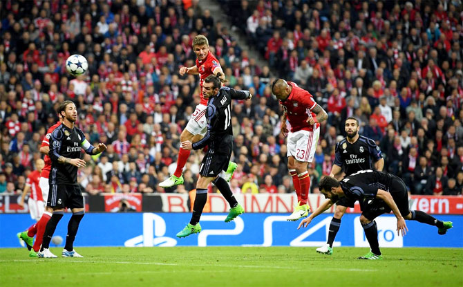 Bayern Munich's Arturo Vidal meets Thiago Alcantara's corner to head in the 25th minute goal against Real Madrid