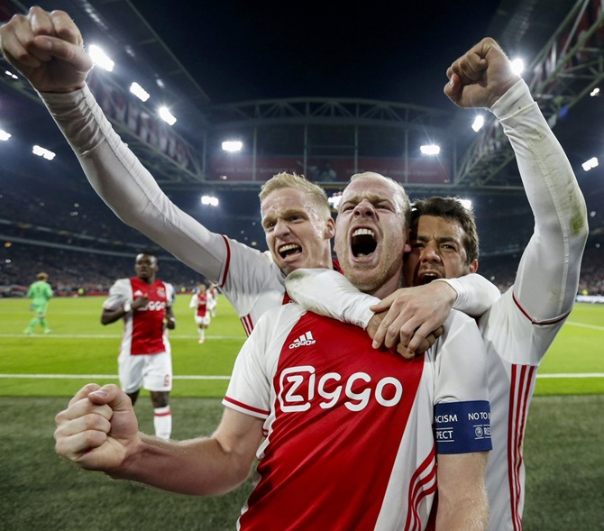 Europa League: Ajax gain, United held, problems delays match at Lyon