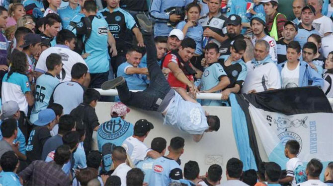 A Belgrano fan sustained head injuries after being thrown from the stands on the suspicion of being a Talleres supporter during a Argentina Primera Division derby match in Cordoba, Argentina on Sunday