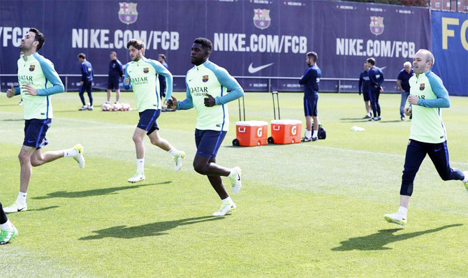 FC Barcelona's players go through the paces at a training session on Thursday