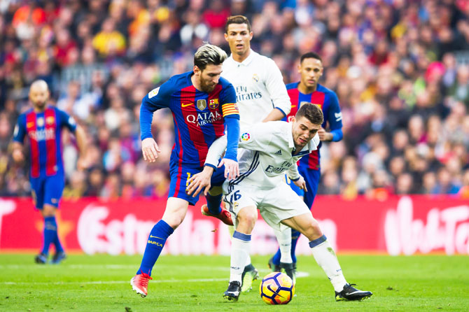 Lionel Messi is challenged by Mateo Kovacic. Messi fequently dropped into midfield to help the team create moves