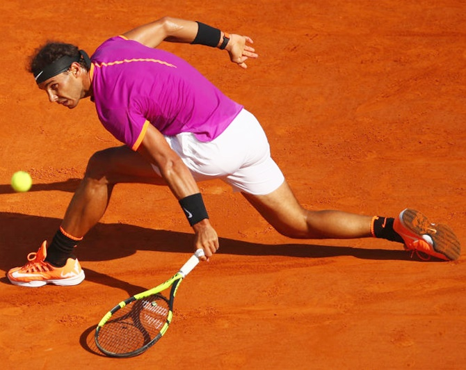 Rediff Sports - Cricket, Indian hockey, Tennis, Football, Chess, Golf - Rare honour for Nadal in Barcelona Open