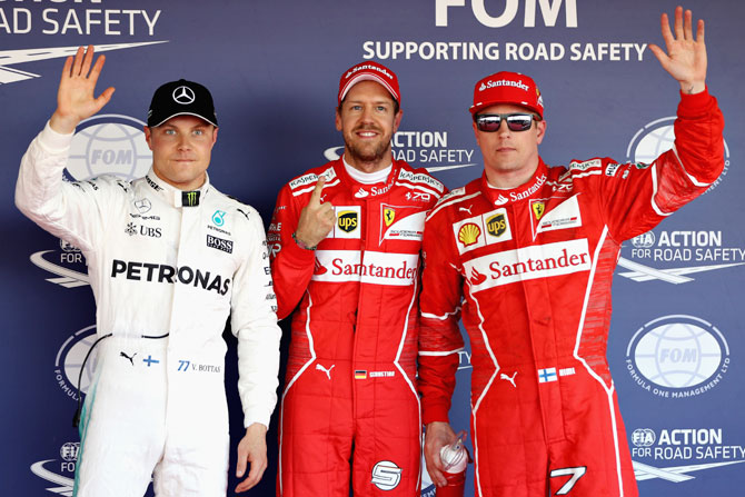 Ferrari's Sebastian Vettel (centre) and Kimi Raikkonen (right) and Mercedes GP's Valtteri Bottas in parc ferme after qualifying for the Formula One Grand Prix of Russia in Sochi on Saturday
