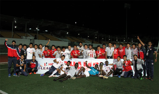 Aizawl FC players celebrate after winning the I-League