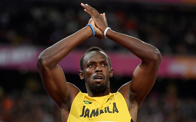 Usain Bolt of Jamaica celebrates winning the 100 metres heat during the World Athletics Championships at London Stadium, London, Britain on Friday