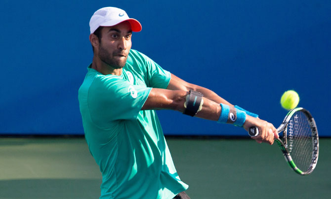 India's Yuki Bhambri plays a return against USA's Kevin Anderson during the Citi Open at William H.G. FitzGerald Tennis Center in Washington DC on Friday