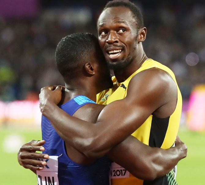 Usain Bolt of Jamaica hugs Justin Gatlin of the United States following Gatlin's win in the men's 100 metres final on Saturday
