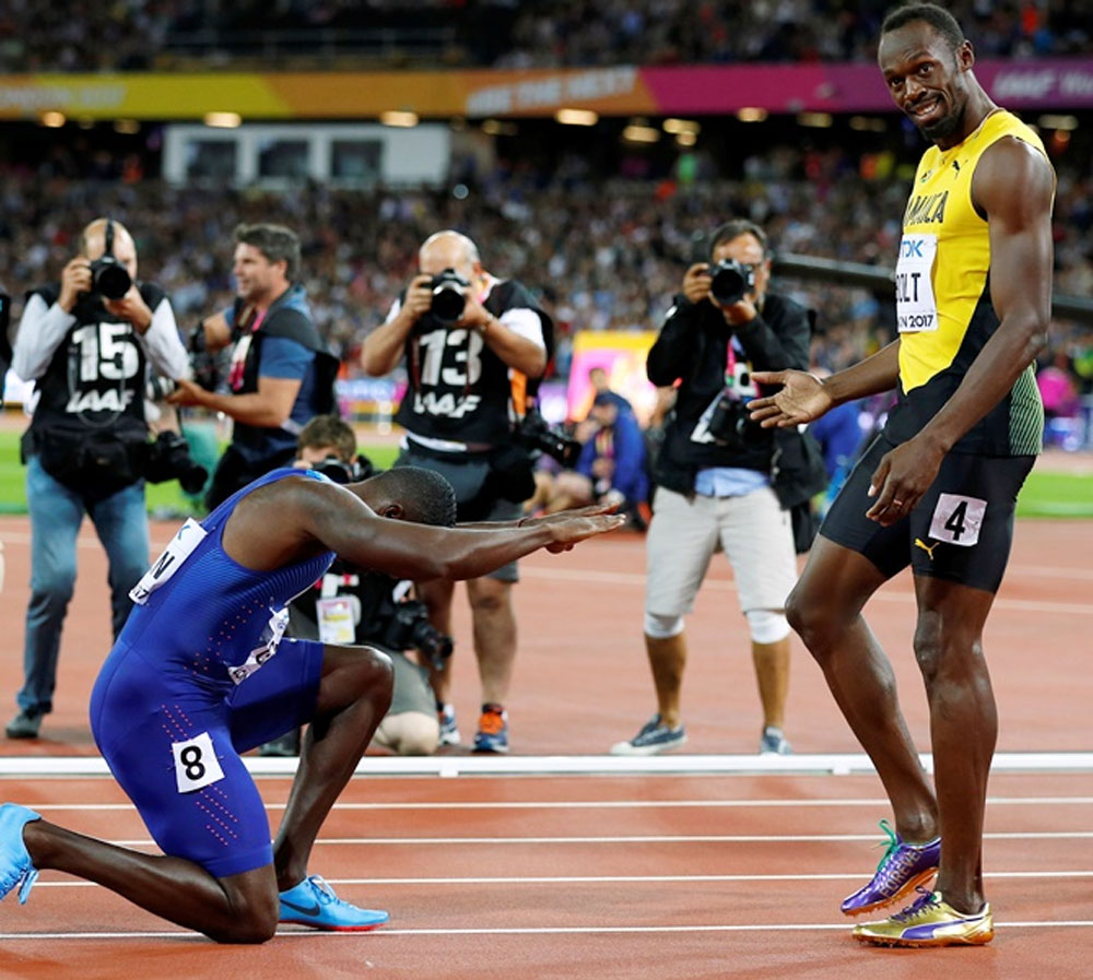 Usain Bolt of Jamaica with Justin Gatlin of the US after the 100m final on Saturday