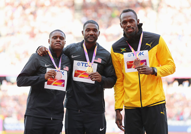 (L-R) Silver medallist Christian Coleman of the United States, gold medallist Justin Gatlin of the United States, and bronze  medallist Usain Bolt of Jamaica, pose with their medals for the Men's 100 metres during day three of the 16th IAAF World Athletics Championships at The London Stadium in London, on Sunday
