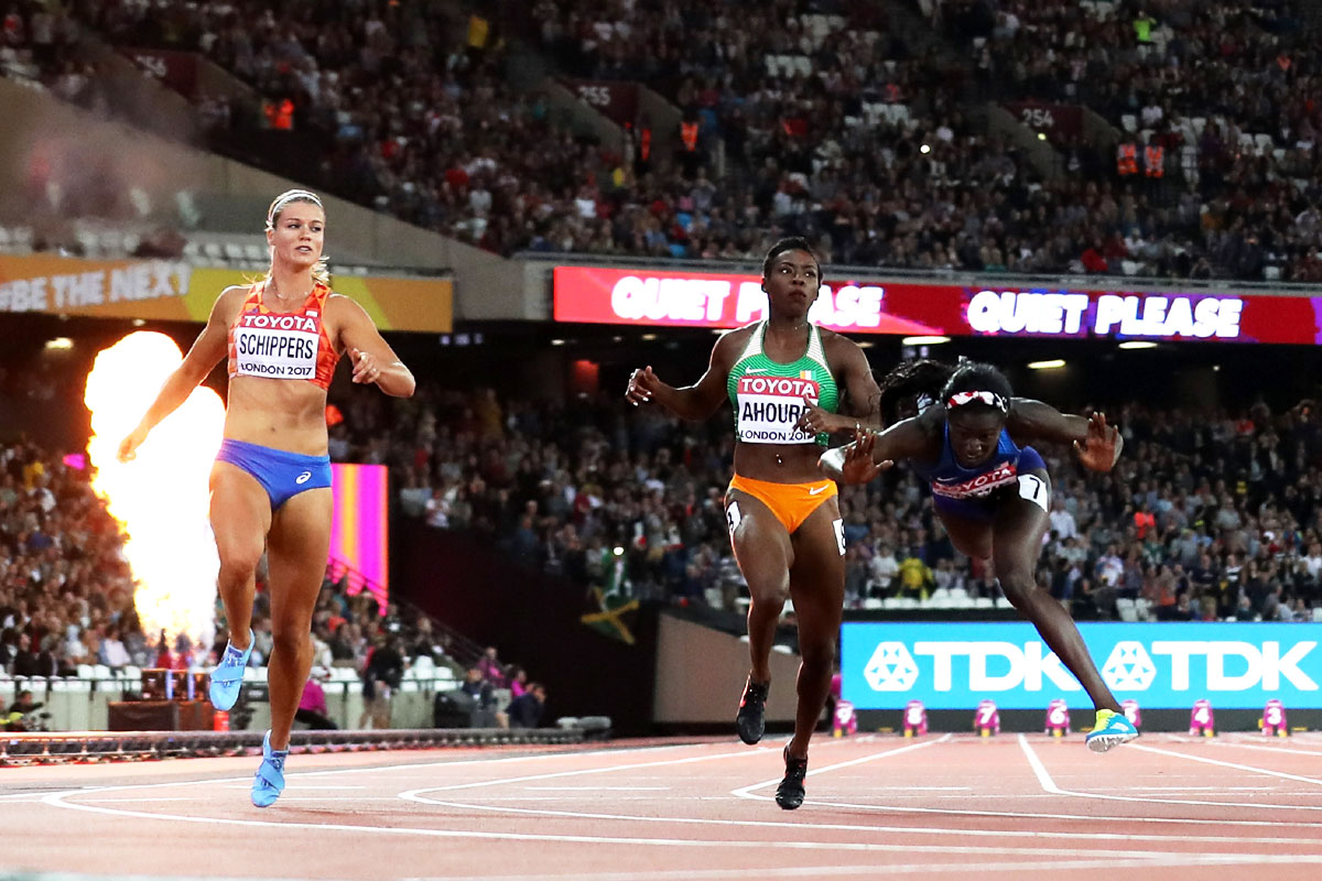 Tori Bowie of the United States trips as she crosses the finish line to win the Women's 100 Metres Final at the 16th IAAF World Athletics Championships at The London Stadium in London, United Kingdom, on Sunday