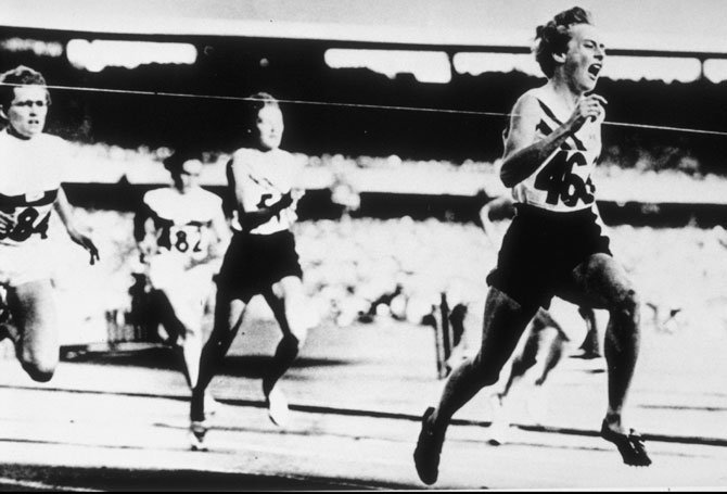 Betty Cuthbert of Australia wins the 200m beating Christa Stubnik of Germany (silver) and Marlene Mathews of Australia ( bronze) during the 1956 Olympic Games in Melbourne, Australia
