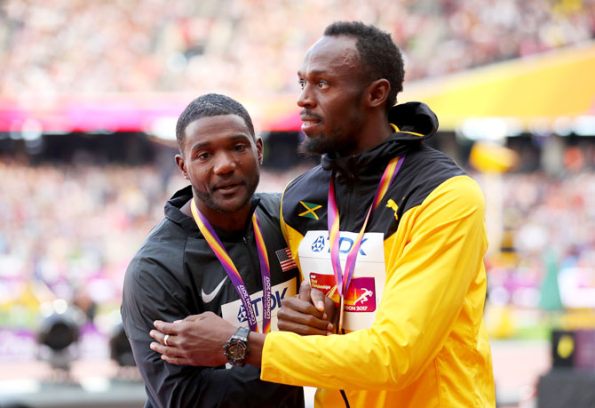 Justin Gatlin of the United States and Usain Bolt of Jamaica embrace during the medal ceremony for the Men's 100 metres final at the 16th IAAF World Athletics Championships at The London Stadium in London, United Kingdom, on Sunday
