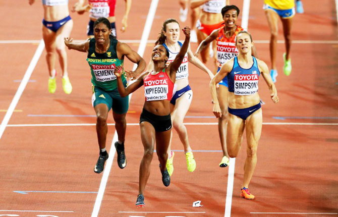 Kenya's Faith Chepngetich Kipyegon (centre) celebrates winning the Women's 1500 Metres final at the World Athletics Championships on Monday