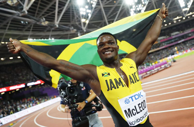 Omar McLeod of Jamaica celebrates winning the men's 110 metres hurdles final on Monday