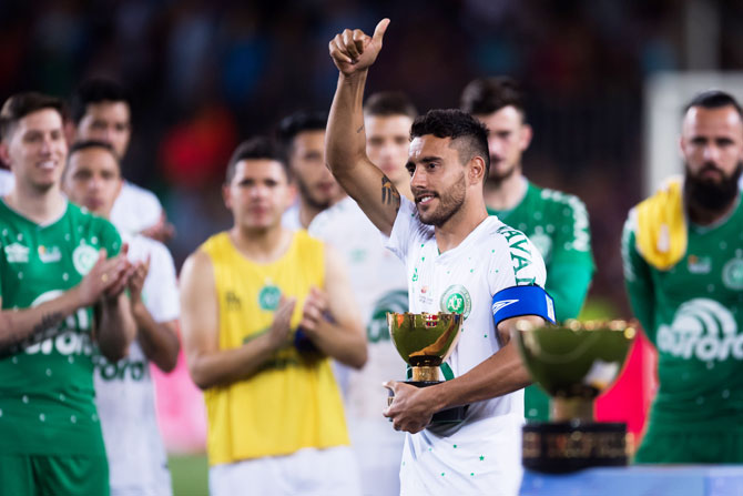 Chapecoense's Alan Ruschel holds the second place trophy after the Joan Gamper Trophy match against FC Barcelona on Monday