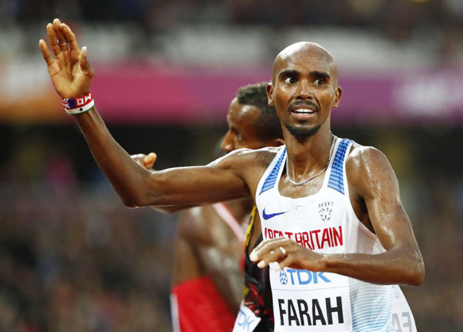 Mo Farah of Britain reacts