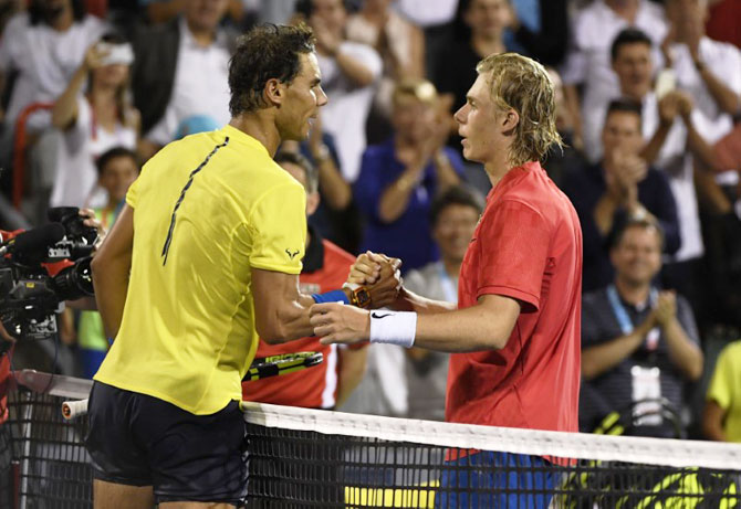 Canada's Denis Shapovalov (right) is congratulated by Spain's Rafael Nadal after their match at the Rogers Cup tennis tournament at Uniprix Stadium in Montreal, Quebec, on Thursday