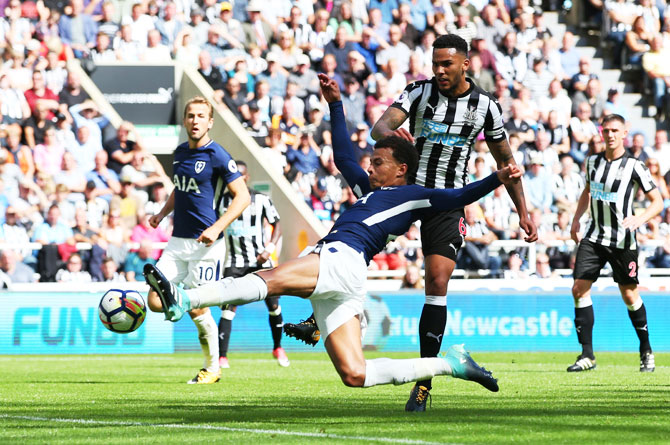 Tottenham Hotspur's Dele Alli scores his sides first goal against Newcastle United during their during the Premier League match at St. James's Park in Newcastle upon Tyne, on Sunday
