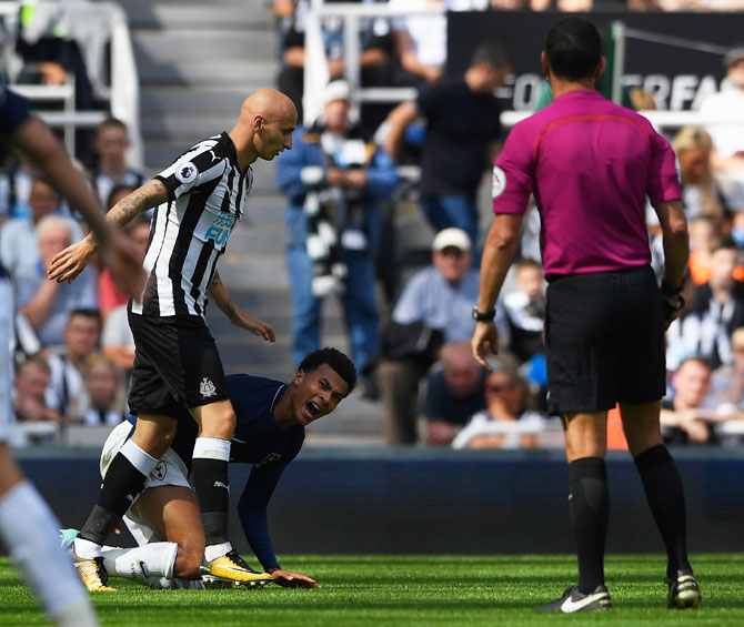 Tottenham Hotspur's Dele Alli reacts leading to a red card for Newcastle United's Jonjo Shelvey