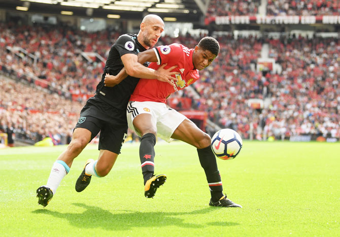 West Ham United's Pablo Zabaleta and Manchester United's Marcus Rashford battle for possession