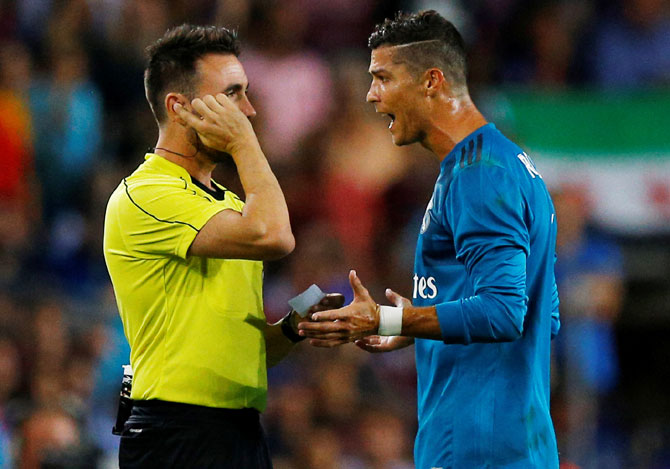 Rediff Sports - Cricket, Indian hockey, Tennis, Football, Chess, Golf - Ronaldo fined and handed FIVE-MATCH ban!
