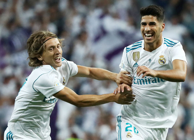 Real Madrid's Marco Asensio celebrates with Luka Modric after scoring the first goal