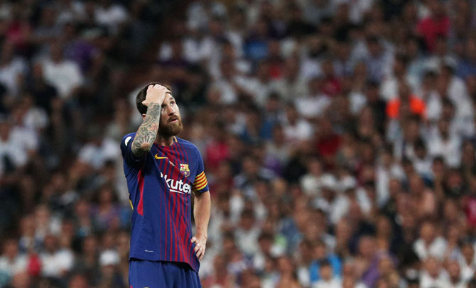 Lionel Messi cuts a dejected figure