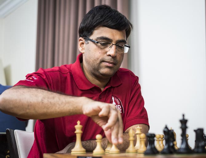 Rediff Sports - Cricket, Indian hockey, Tennis, Football, Chess, Golf - Tata Steel chess: Anand draws with Karjakin, Carlsen beats Adhiban