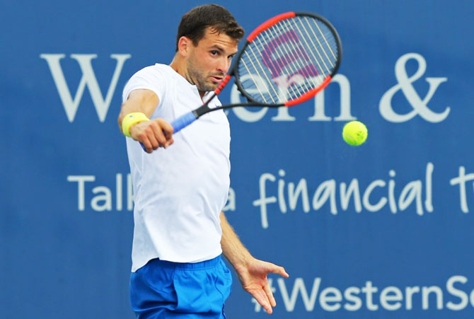 Bulgaria's Grigor Dimitrov returns a shot against Argentina's Juan Martin del Potro during the Cincinnati Western and Southern Open at the Lindner Family Tennis Center in Mason, Ohio on Thursday