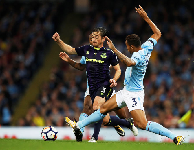 Everton's Leighton Baines challebnges Manchester City's Danilo