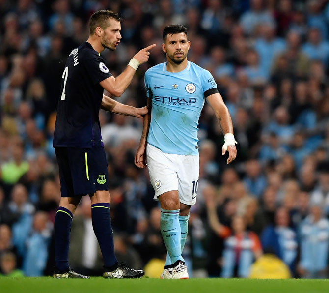 Everton's Morgan Schneiderlin and Manchester City's Sergio Aguero square up after Everton's Morgan Schneiderlin is shown the red card