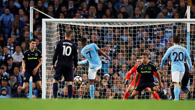 Manchester City's Raheem Sterling bangs in a breathtaking volley into the back of the net to scores the equaliser against Everton during their English Premier League match at Etihad Stadium on Monday