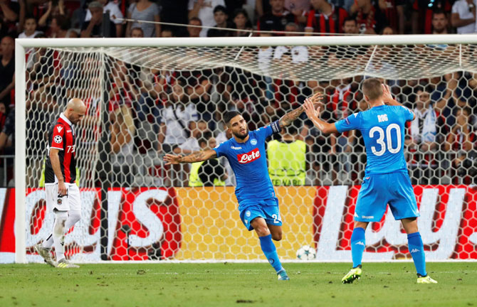 Napoli's Lorenzo Insigne celebrates scoring their second goal against Nice during the Champions League Playoffs in Nice on Tuesday